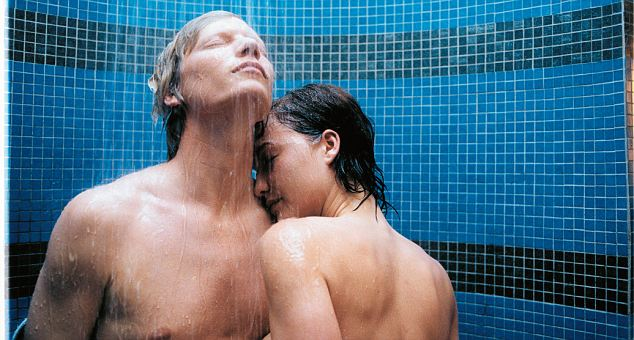 Young couple having a shower --- Image by © Jonny Le Fortune/Corbis